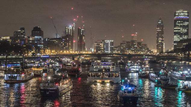 Boats line up in the Thames after watching New Years Eve fireworks in London England.