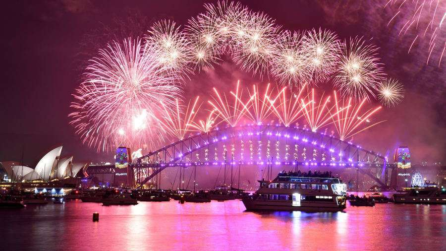 Sydney Australia Fireworks erupt over Sydneys iconic Harbour Bridge and Opera House.